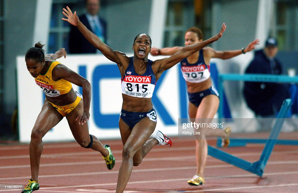 Michelle Perry of the United States celebrates after winning the women's 100-meter hurdles in 12.66 in the IAAF World Champoinships in Athletics at Olympic Stadium in Helsinki, Finland on Thursday, August 11, 2005. Delloreen Ennis-London of Jamaica (left) was second in 12.76 and Joanna Hayes (rigtht) was disqualified after a crashing into the final hurdle.