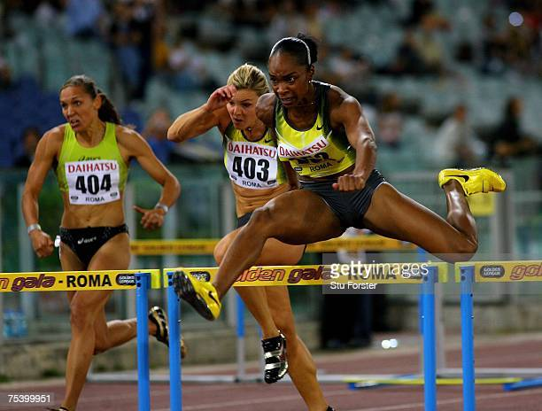 Michelle Perry of the USA clears the last hurdle before going on to win the Womens 100 metres Hurdles during the IAAF Golden Gala at The Olympic...