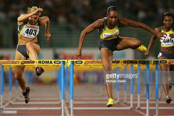 Michelle Perry of USA clears the last hurdle to win the women's 100m hurdles from Susanna Kallur of Sweden during the IAAF Golden Gala meeting at the...