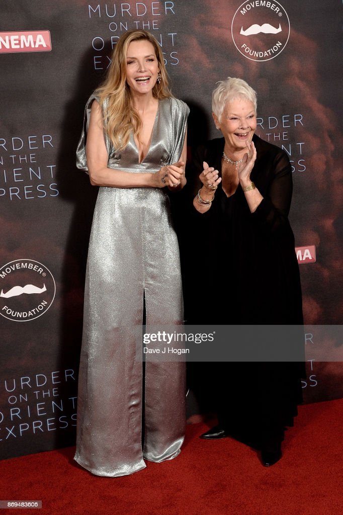 Michelle Pfeiffer (L) and Dame Judi Dench attend the 'Murder On The Orient Express' World Premiere at Royal Albert Hall on November 2, 2017 in London, England.