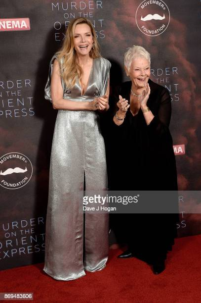 Michelle Pfeiffer and Dame Judi Dench attend the 'Murder On The Orient Express' World Premiere at Royal Albert Hall on November 2 2017 in London...