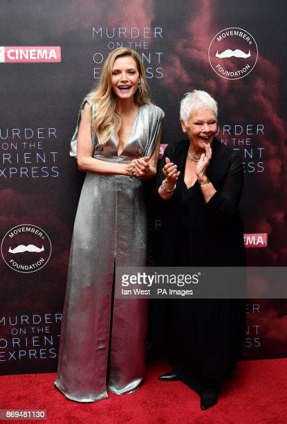 Michelle Pfeiffer and Dame Judi Dench attending the world premiere of Murder On The Orient Express at the Royal Albert Hall London