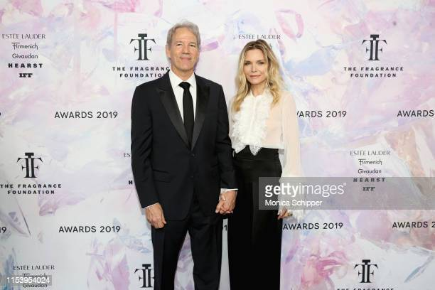 Michelle Pfeiffer and David E Kelley attend the 2019 Fragrance Foundation Awards at David H Koch Theater at Lincoln Centeron June 05 2019 in New York...