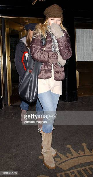 Michelle Pfeiffer and her daughter Claudia Rose leave a midtown hotel on February 18 2007 in New York City