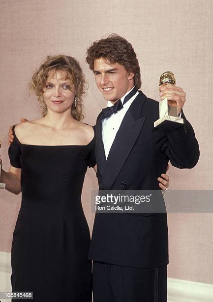 Michelle Pfeiffer and Tom Cruise during The 47th Annual Golden Globe Awards at The Beverly Hilton Hotel in Beverly Hills California United States