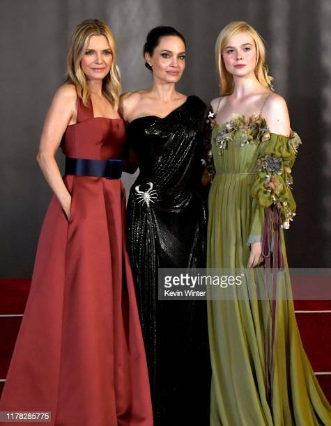 """Michelle Pfeiffer, Angelina Jolie and Elle Fanning arrive at the premiere of Disney's """"Maleficent: Mistress Of Evil"""" at the El Capitan Theatre on..."""
