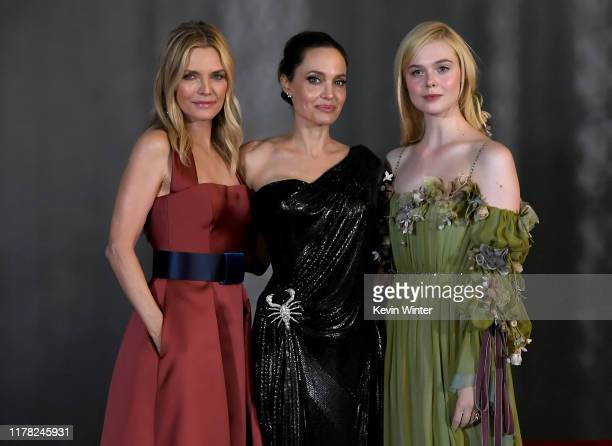 "Michelle Pfeiffer, Angelina Jolie, and Elle Fanning attend the world premiere of Disney's ""Maleficent: Mistress Of Evil"" at El Capitan Theatre on..."