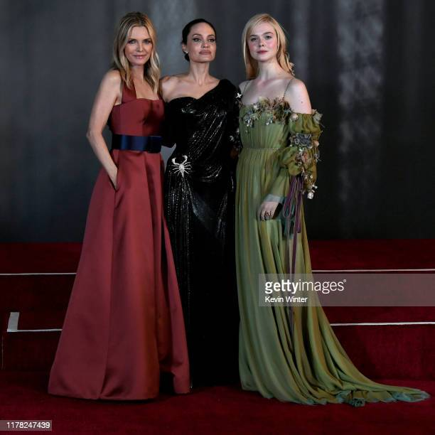 """Michelle Pfeiffer, Angelina Jolie, and Elle Fanning attend the world premiere of Disney's """"Maleficent: Mistress Of Evil"""" at El Capitan Theatre on..."""