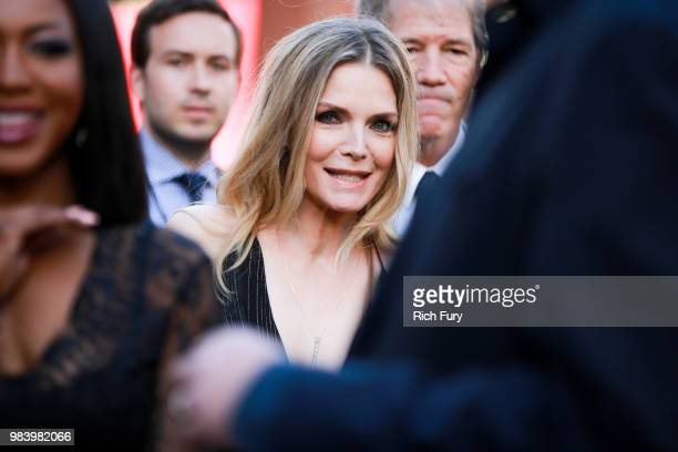 Michelle Pfeiffer attends the premiere of Disney And Marvel's 'AntMan And The Wasp' on June 25 2018 in Hollywood California