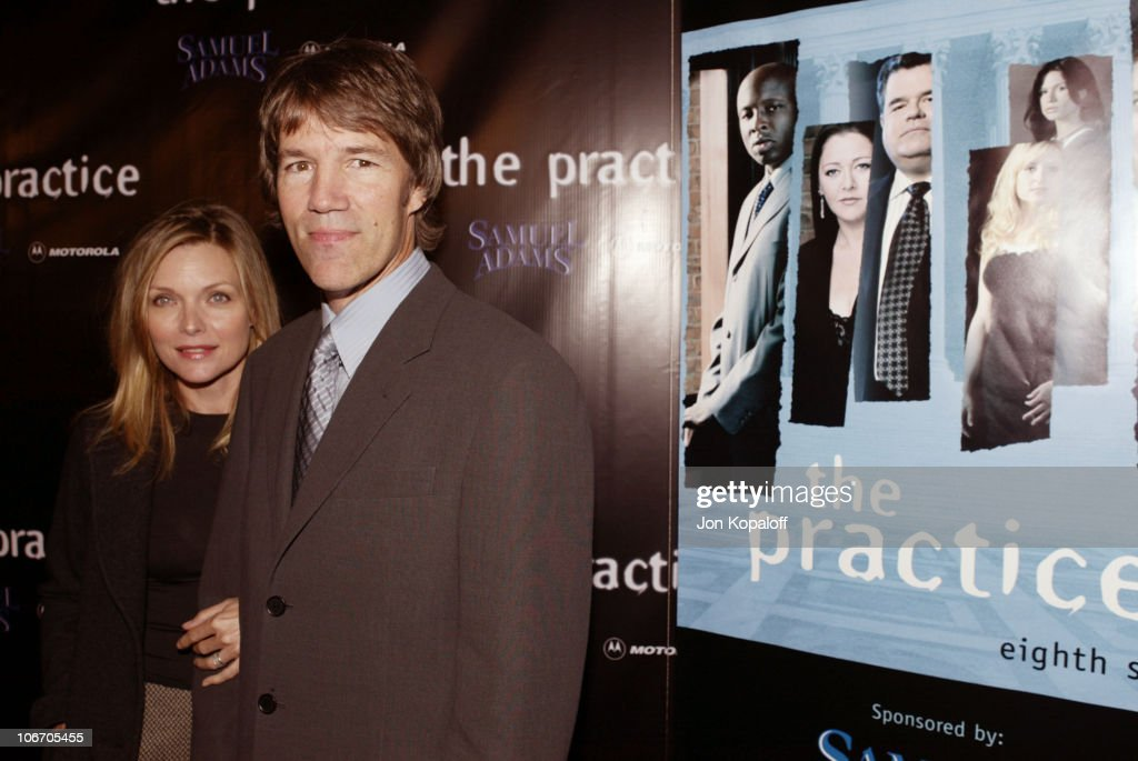 Michelle Pfeiffer & David E. Kelley during David E. Kelley and the cast of ABC's hit drama, 'The Practice,' celebrate the launch of their eighth season at The Buffalo Club in Santa Monica, California, United States.
