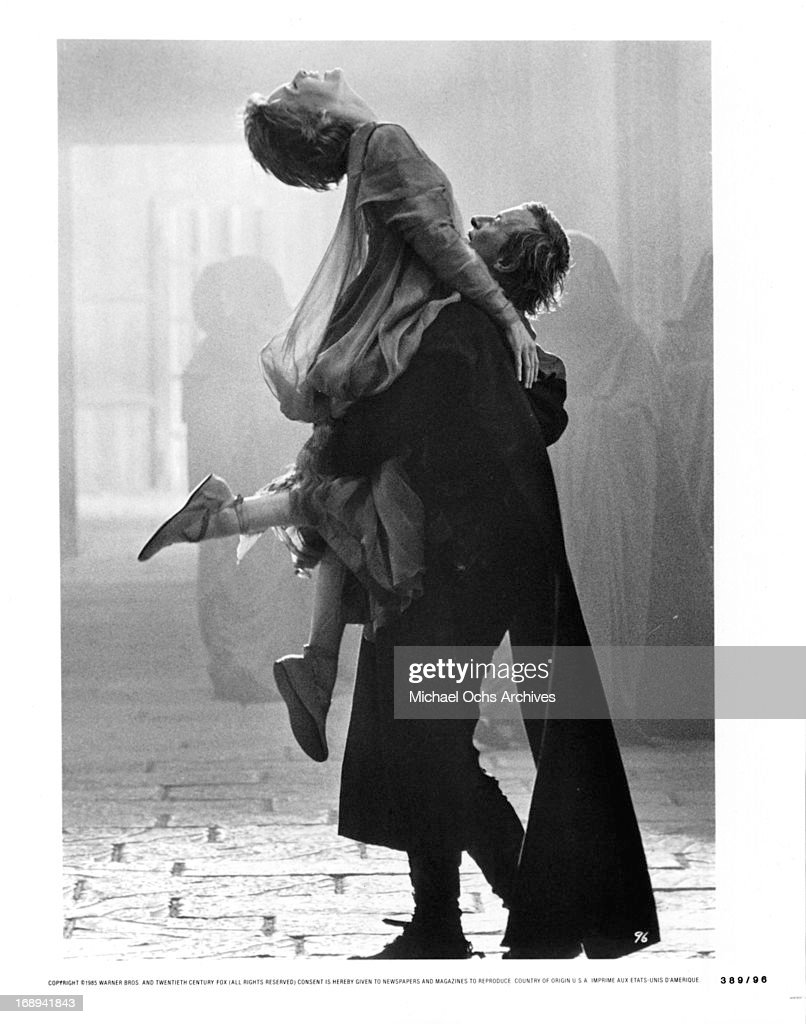 https://media.gettyimages.com/photos/michelle-pfeiffer-is-lifted-by-rutger-hauer-in-a-scene-from-the-film-picture-id168941843