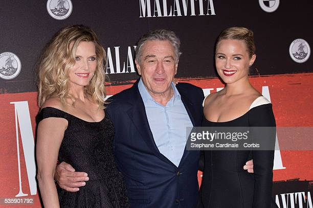 Michelle Pfeiffer Robert De Niro and Dianna Agron attend the 'Malavita' premiere at Europacorp Cinemas at Aeroville Shopping Center in RoissyenFrance...