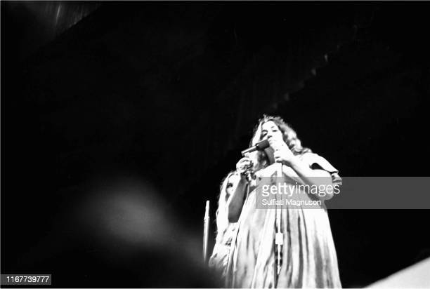Michelle Phillips and Mama Cass Elliot apparently looking at this photographer performing with the band The Mamas The Papas were the next to last act...