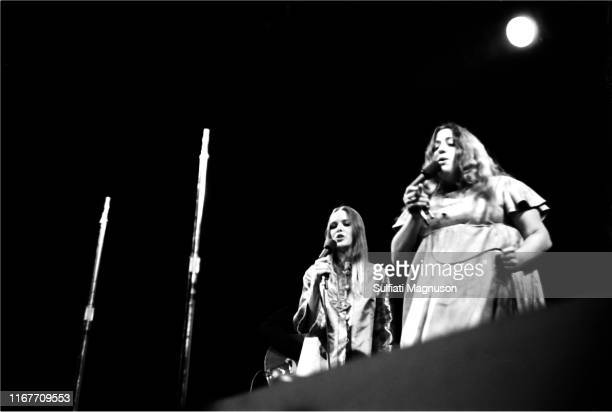 Michelle Phillips and Mama Cass Elliot in their silk/satin/brocaded garb performing with the band The Mamas The Papas The two engaged with the...