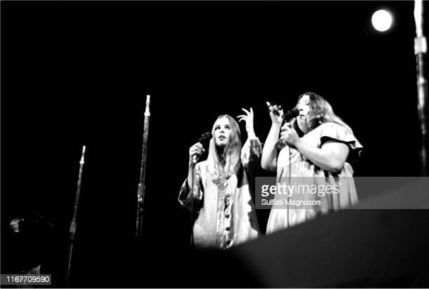 Michelle Phillips and Mama Cass Elliot of the band The Mamas The Papas singing gesturing with upraised hands as they performed at the Monterey...
