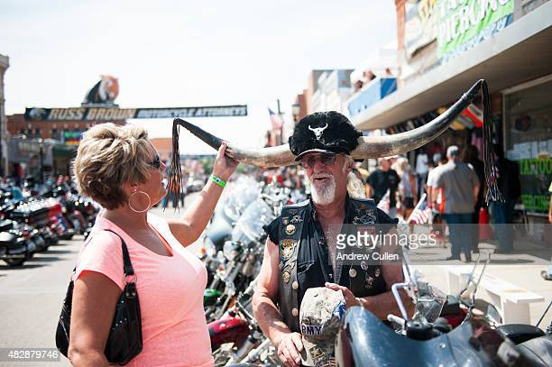 Michelle Pollman asks Ken Ammerman about his unique motorcycle helmet on the first day of the annual Sturgis Motorcycle Rally August 3 2015 in...