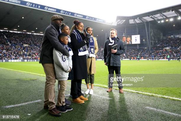 Michelle Regis daughter of Cyrille Regis speaks during half time surrounded by family during the Premier League match between West Bromwich Albion...
