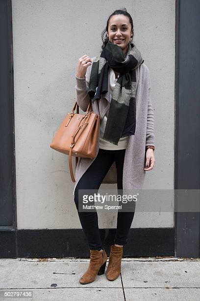 Michelle Renar is seen on Michigan Avenue wearing a grey cashmere Halogen cardigan light brown Tory Burch bag and brown Italian suede shoes on...