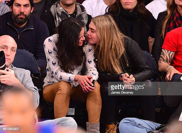Michelle Rodriguez and Cara Delevingne attend the Detroit Pistons vs New York Knicks game at Madison Square Garden on January 7 2014 in New York City