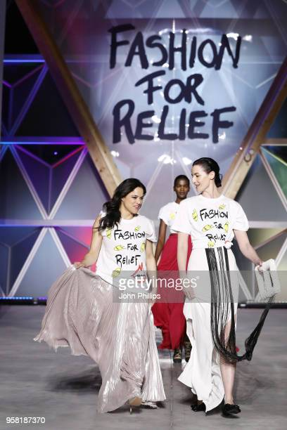 Michelle Rodriguez and models walk the Runway at Fashion for Relief Cannes 2018 during the 71st annual Cannes Film Festival at Aeroport Cannes...