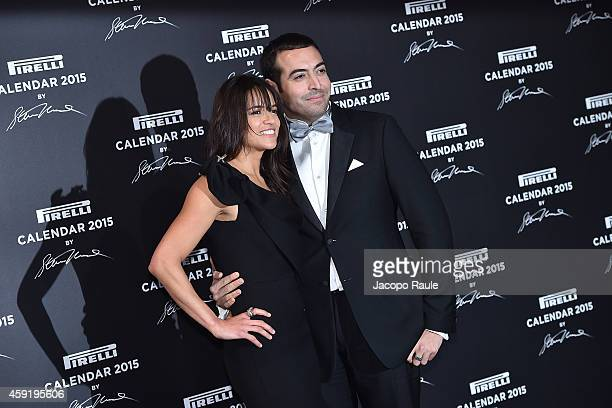 Michelle Rodriguez and Mohammed al Turki attend the 2015 Pirelli Calendar Red Carpet on November 18 2014 in Milan Italy