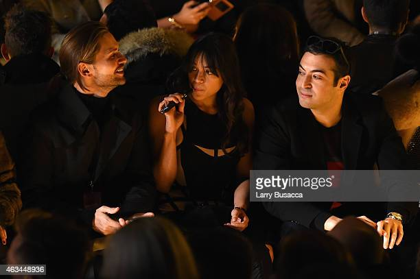 Michelle Rodriguez and Mohammed Al Turki attend the Herve Leger By Max Azria fashion show during MercedesBenz Fashion Week Fall 2015 at The Theatre...