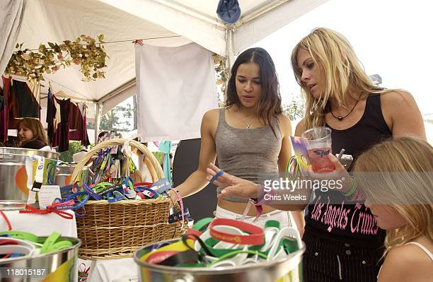Michelle Rodriguez and Nicole Eggert at Attitude Bands Photo by Chris Weeks/WireImage for Silver Spoon