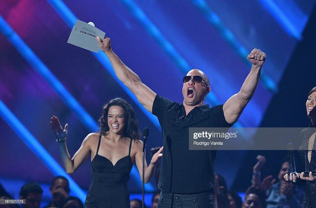 Michelle Rodriguez and Vin Dieselon stage at Billboard Latin Music Awards 2013 at Bank United Center on April 25, 2013 in Miami, Florida.