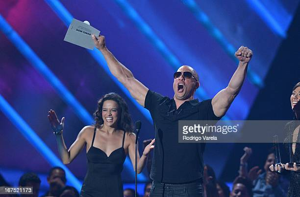 Michelle Rodriguez and Vin Dieselon stage at Billboard Latin Music Awards 2013 at Bank United Center on April 25 2013 in Miami Florida