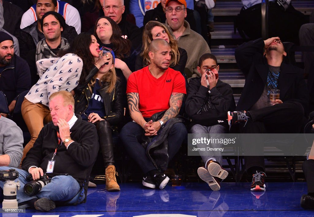 Michelle Rodriguez, Cara Delevingne, Miguel Cotto, Miguel Cotto Jr and guest attend the Detroit Pistons vs New York Knicks game at Madison Square Garden on January 7, 2014 in New York City.