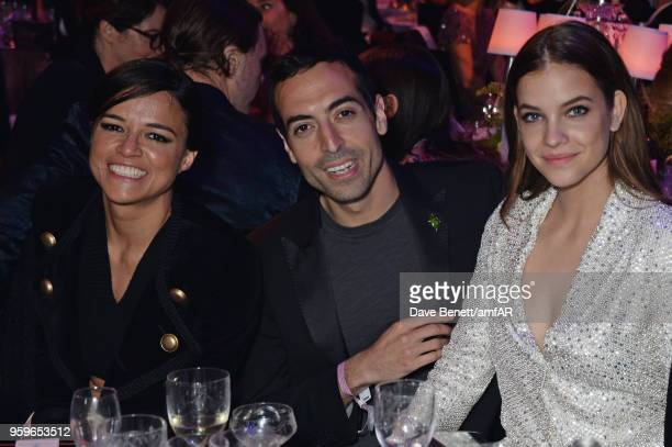 Michelle Rodriguez Mohammed Al Turki and Barbara Palvin attend the amfAR Gala Cannes 2018 dinner at Hotel du CapEdenRoc on May 17 2018 in Cap...