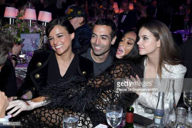 Michelle Rodriguez, Mohammed Al Turki, Winnie Harlow and Barbara Palvin attend the amfAR Gala Cannes 2018 dinner at Hotel du Cap-Eden-Roc on May 17,...