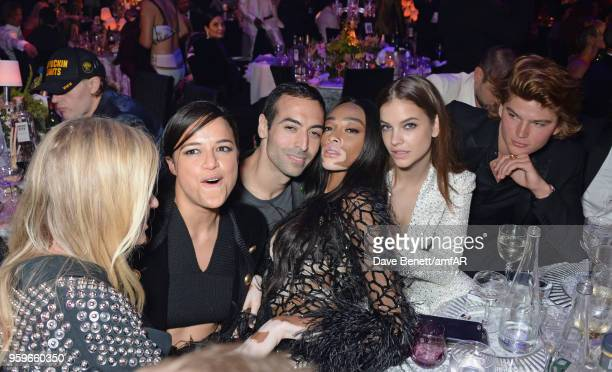 Michelle Rodriguez Mohammed Al Turki Winnie Harlow Barbara Palvin and Jordan Barrett attend the amfAR Gala Cannes 2018 dinner at Hotel du CapEdenRoc...