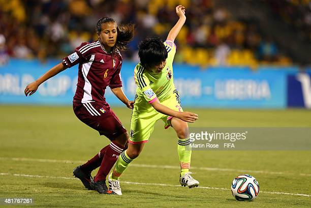 Michelle Romero of Venezuela and Shiho Matsubara of Japan battle for the ball during the FIFA U17 Women's World Cup 2014 semi final match between...