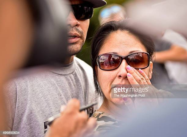 Michelle Romero, right, wipes tears after being reunited with her husband Adam Romero, left, on San Bernardino Ave Thursday afternoon. Michelle...