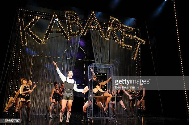Michelle Ryan and Will Young perform during a photocall for 'Caberet' at The Savoy Theatre on October 8 2012 in London England