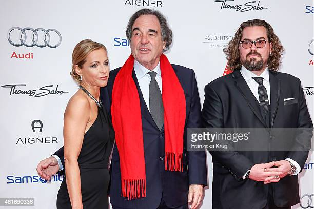 Michelle SchulzDeyle Oliver Stone and Philip SchulzDeyle attend the German Film Ball 2015 on January 17 2015 in Munich Germany