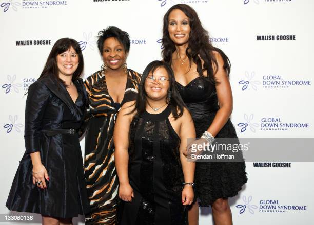 Michelle Sie Whitten executive director of the Global Down Syndrome Foundation Model Beverly Johnson singer Gladys Knight and Natalie Fuller arrive...