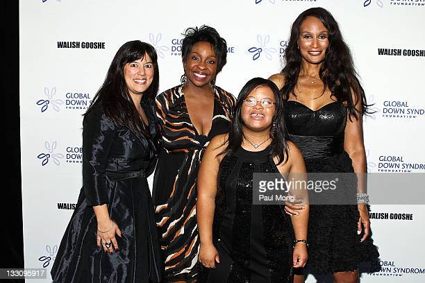 Michelle Sie Whitten executive director of the Global Down Syndrome Foundation Gladys Knight Natalie Fuller and Beverly Johnson arrive inaugural 2011...