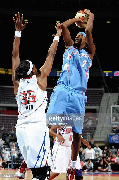 Michelle Snow of the Atlanta Dream goes up for a shot over Cheryl Ford of the Detroit Shock in Game one of the Eastern Conference Semifinals during...