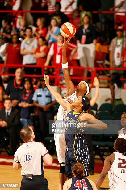 Michelle Snow of the Houston Comets and Tammy Sutton-Brown of the Indiana Fever tip-off at Reliant Arena on June 28, 2008 in Houston, Texas. NOTE TO...