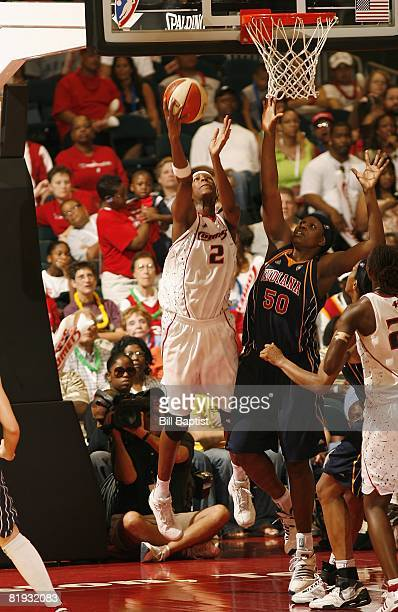 Michelle Snow of the Houston Comets lays up a shot against Bernadette Ngoyisa of the Indiana Fever during the game at Reliant Arena on June 28, 2008...