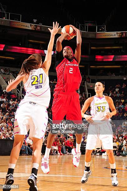 Michelle Snow of the Houston Comets shoots against Brooke Smith the Phoenix Mercury on September 7 at US Airways Center in Phoenix Arizona NOTE TO...