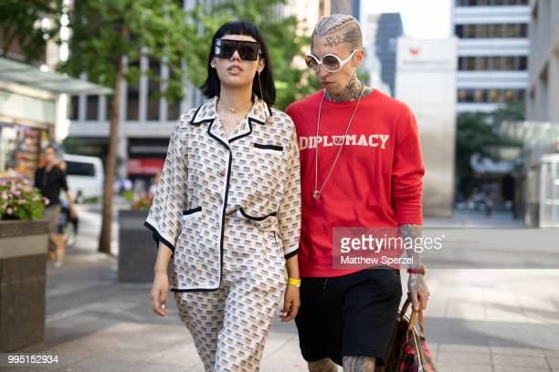 Michelle Song and Chris Lavish are seen on the street attending Men's New York Fashion Week on July 9 2018 in New York City