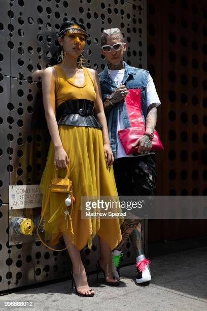Michelle Song and Chris Lavish are seen on the street during Men's New York Fashion Week on July 11 2018 in New York City