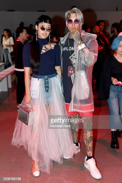 Michelle Song and Chris Lavish attend the Michael Costello show during New York Fashion Week The Shows at Gallery II at Spring Studios on September 7...