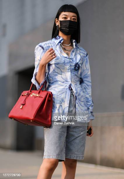 Michelle Song is seen wearing a Jacquemus top Alessandra Rich shorts and red Hermes bag outside the Rebecca Minkoff show during New York Fashion Week...