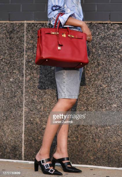 Michelle Song is seen wearing a Jacquemus top Alessandra Rich shorts Misbhv shoes and a red Hermes bag outside the Rebecca Minkoff show during New...