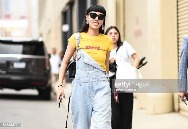 Michelle Song is seen wearing a Vetements DHL yellow tshirt and jean overalls outside the Parke Ronen show during New York Fashion Week Men's S/S...