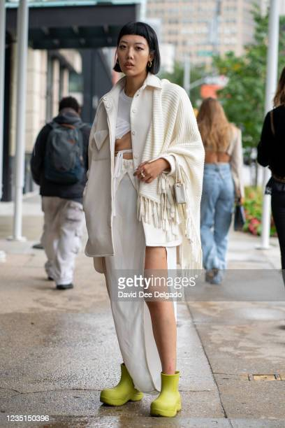 Michelle Song is seen wearing jacket and dress by Bevza and boots by Bagllet while departing the Bevza Spring Summer 2022 fashion show at Spring...